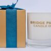 Bridge Park Candle Company Portofino candle and gold box tied with a teal coloured ribbon