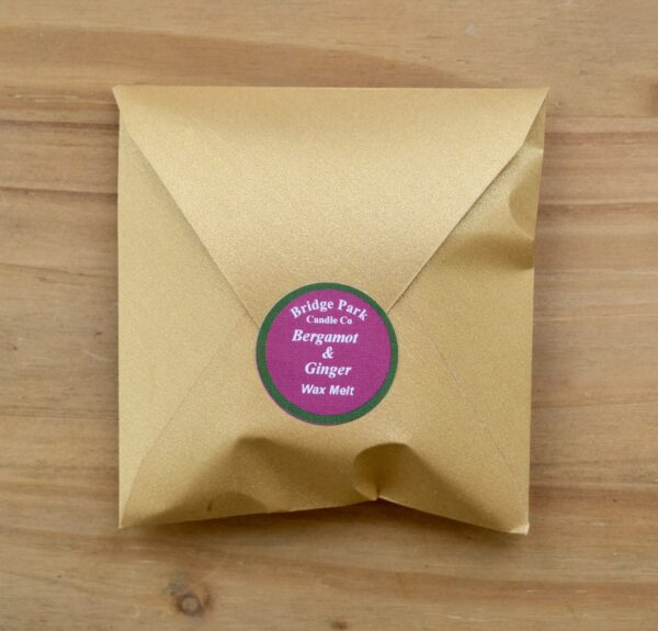 Bridge Park Candle Company Bergamot & Ginger Wax Melt in a small gold envelope