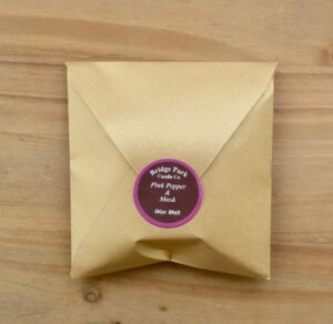 Bridge Park Candle Company Pink Pepper & Musk Wax Melt in a small gold envelope