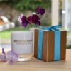 Bridge Park Company candle with sweet peas and garden in the background