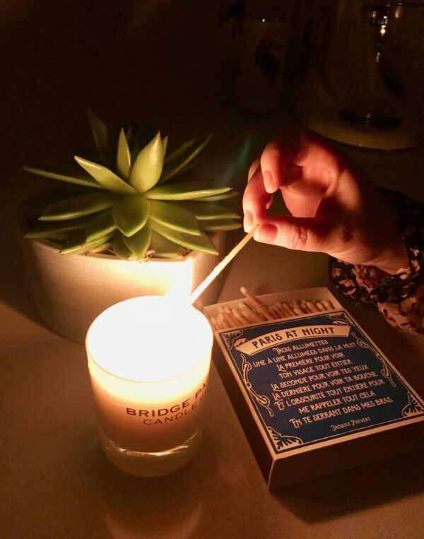 Bridge Park Candle Company candle being lit by an extra long letterpress printed luxury match