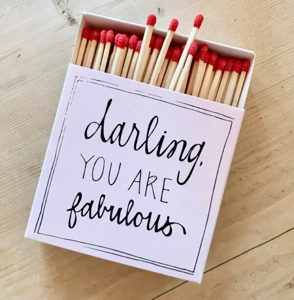 Pink box of luxury matches with darling you are fabulous written on the front