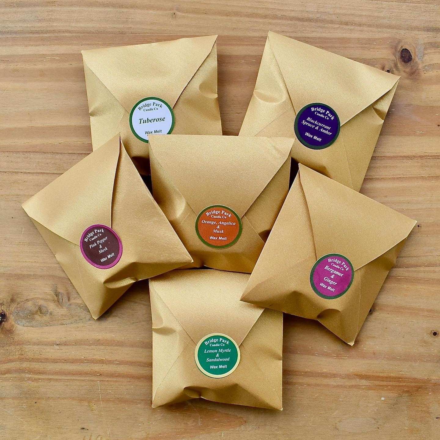 A selection of wax melts in square gold envelopes